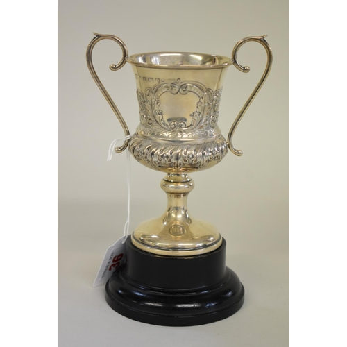 36 - <strong>An Edwardian silver twin handled trophy cup</strong>, <em>by Joseph Lester Ltd,</em> Birming...