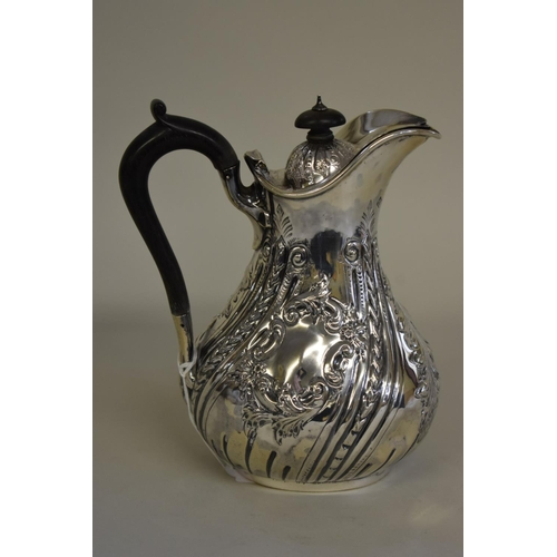 37 - <strong>A Victorian silver hot water jug,</strong> <em>by Martin, Hall & Co, </em>Sheffield 1893...