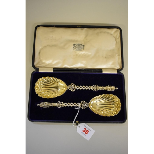 38 - <strong>A cased pair of Victorian silver gilt apostle serving spoons,</strong><em>by</em><em>John ...