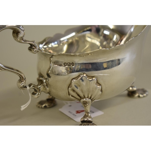 4 - <strong>A pair of Edwardian silver George III style sauce boats,</strong><em>by Henry Stratford Ltd...