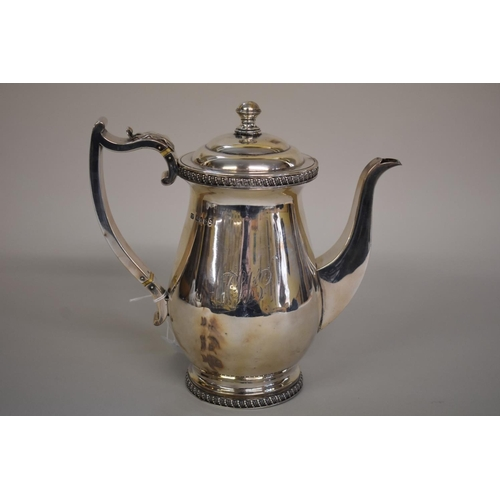 5 - <strong>A George lll silver hot water jug,</strong><em>by Charles Fox,</em> London 1817, 20.5cm hig...
