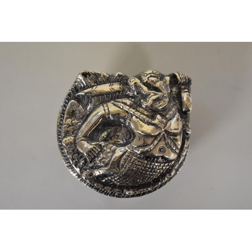 53 - <strong>An Indian metal lidded trinket box,</strong> decorated mythical warrior, 4cm high....