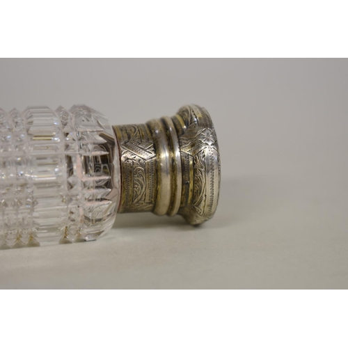 55 - <strong>A hobnail cut glass&nbsp;double ended scent bottle</strong>, having chased gilt metal ends, ...