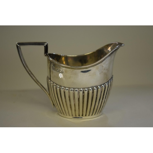 9 - <strong>A silver Queen Anne style cream jug,&nbsp;</strong><em>by Walker &amp; Hall, </em>Sheffield ...