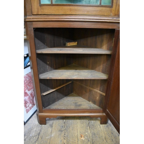 1212 - <strong>A 19th century mahogany and line inlaid standing corner cupboard,</strong>with glazed ...