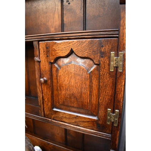 1217 - <strong>A reproduction oak panelled</strong><strong> dresser and rack,</strong> 156cm wide....