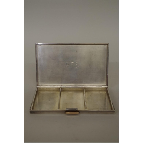 42 - <strong>An Art Deco sterling silver and gold plated cigarette box,</strong> having French hallmarks ...