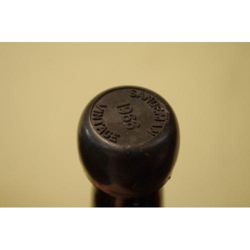 512 - <strong>A bottle of Sandeman 1966 vintage port,</strong> bottled by Grants of St James's Ltd....