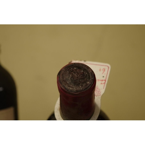 521 - <strong>Two bottles of Clos Rene Pomerol 1961,</strong> Grants of St James. (2)...