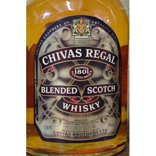 523 - <strong>Two bottles of whisky,</strong> comprising: a 1 litre Chivas Regal 12 year old blended; and ...