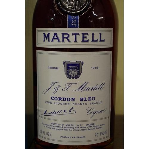524 - <strong>A 24 fl.oz. bottle of Martell Cordon Bleu cognac,</strong> 1960s bottling, in card box....