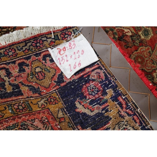 1201 - <strong>An old Persian rug, </strong>having allover floral and geometric decoration, a.f. 155 x 112c...