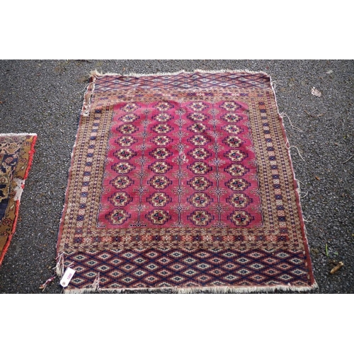 1200 - <strong>An old Persian rug,</strong>having repeated gul design to central field with geometric and ...
