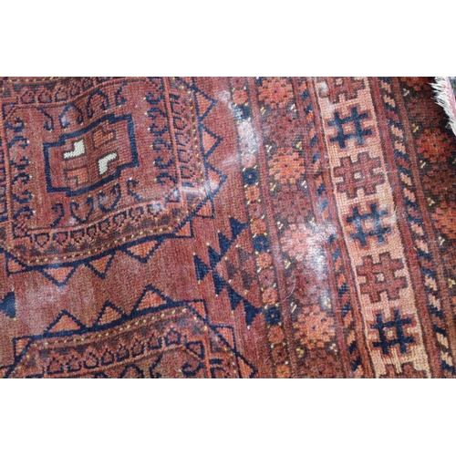 1202 - <strong>An Afghan rug,</strong>having six central medallions with floral and geometric borders, 150...