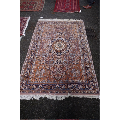 1205 - <strong>A Persian rug, </strong>having central floral medallion with floral and geometric borders, 2...