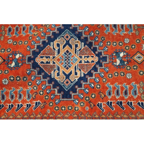 1206 - <strong>A Persian rug, </strong>having central field decorated medallions and animal motifs with a g...