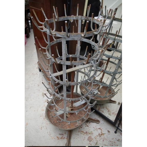 1210 - <strong>A vintage French galvanised 'hedgehog' bottle drainer,</strong>95.5cm high....
