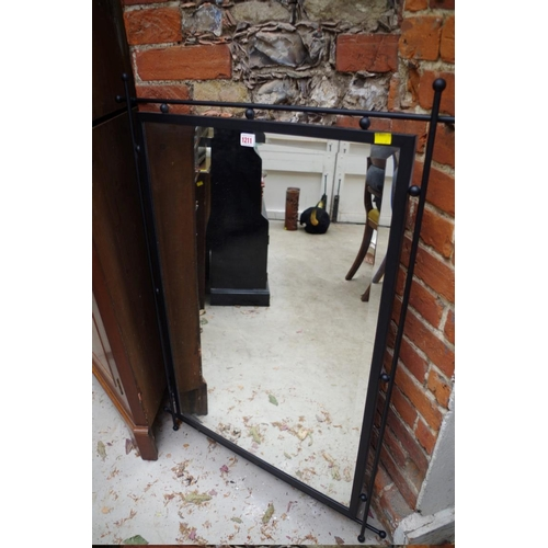 1211 - <strong>A modern black painted metal framed wall mirror,</strong> 111 x 80cm....