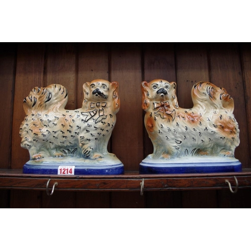 1214 - <strong>A pair of pottery King Charles Spaniels,</strong>21cm wide....