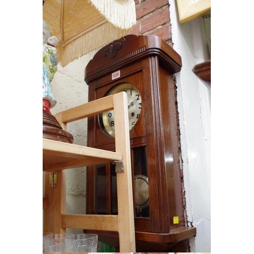 1225 - <strong>A 1920s oak wall clock.</strong>...