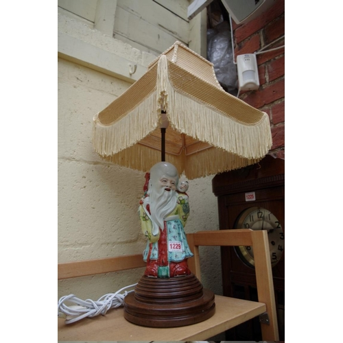 1229 - <strong>A Chinese famille rose figural table lamp,</strong>the figure 26cm high....