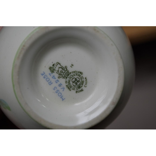 1234 - <strong>A Royal Doulton 'Moss Rose' pattern part tea service.</strong>...