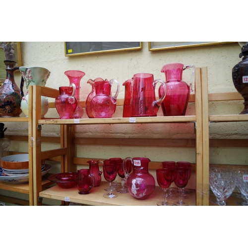 1235 - <strong>A collection of cranberry glass. </strong>(two shelves)...