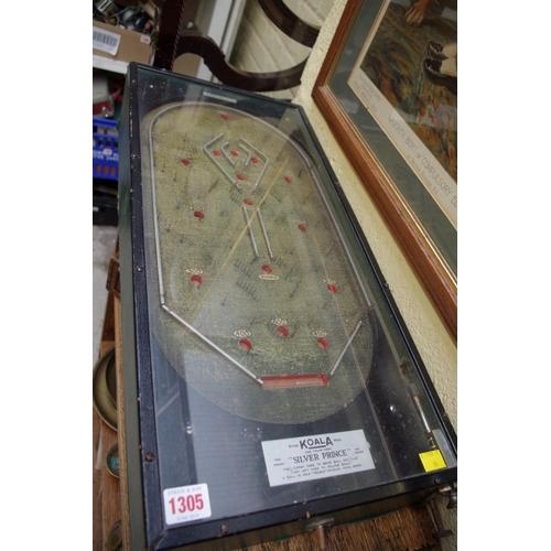 1305 - <strong>AKoala Silver Prince pinball machine,</strong> 63.5cm long....