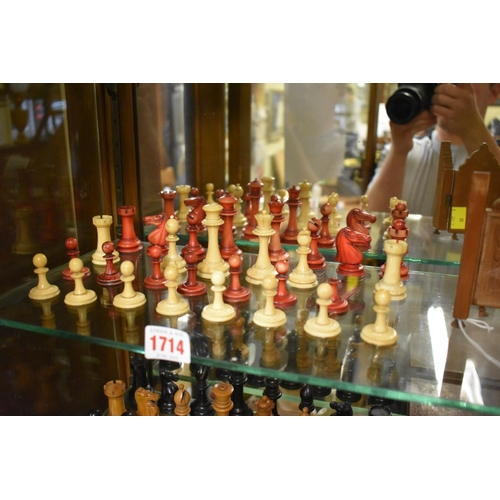 1714 - <strong>A late 19th century bone Staunton pattern part chess set,</strong>red stained and natural, ...