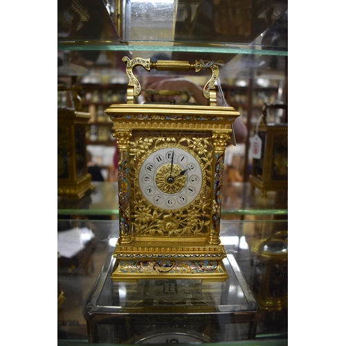 1744 - <strong>A good and large gilt brass and champleve enamel carriage clock,</strong> by E Maurice &...