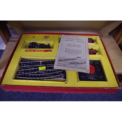 1867 - <strong>A Triang R3.E train set;</strong> together with R.23 Operating Mail Coach set, both boxed.&n...