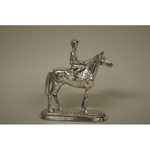 14 - <strong>A filled silver model of racehorse and jockey,</strong> <em>by Camelot Silverware Ltd, </em>...