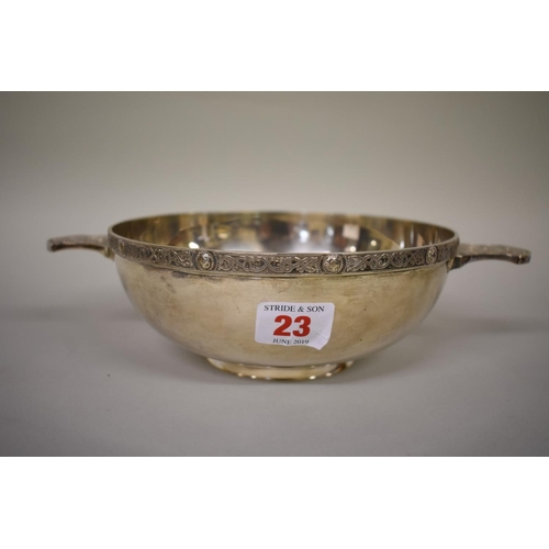 23 - <strong>A large silver twin handled Celtic quaich</strong>, <em>by Wakely & Wheeler,</em>L...