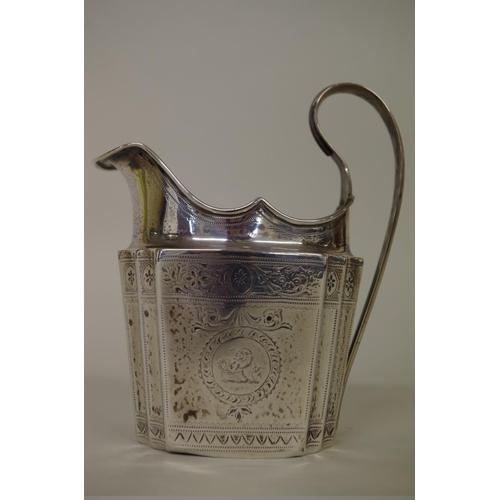 25 - <strong>An Irish George lll silver milk jug,</strong><em>by John Stoyte,</em>Dublin 1794, 13.5cm h...