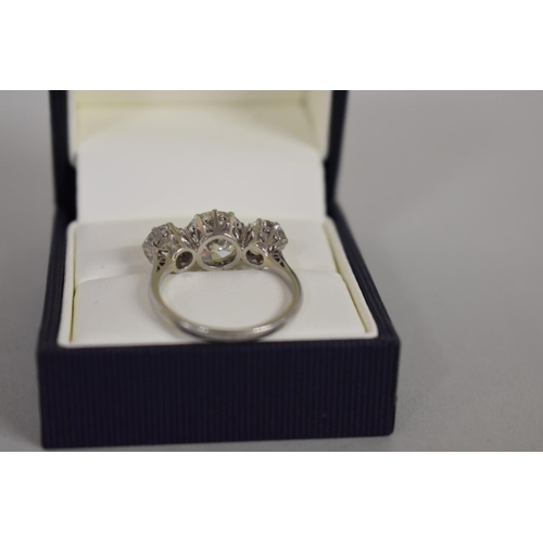 291 - <strong>An old European cut diamond and platinum three stone ring, </strong>the central stone 2.6ct,...