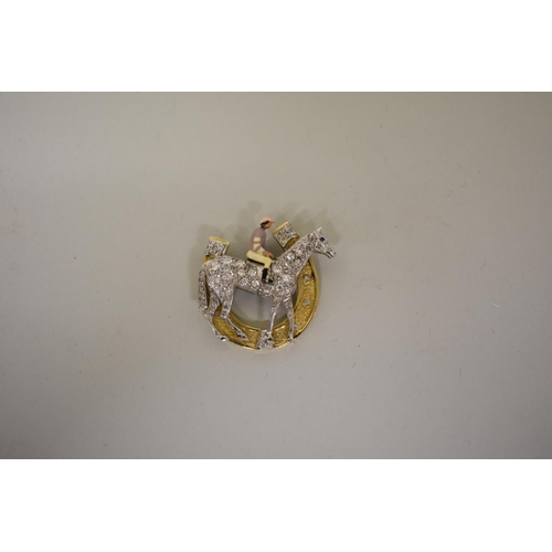 299 - <strong>WITHDRAWN FROM SALE - A diamond encrusted race horse pendant,</strong> with sapphire eye, th...