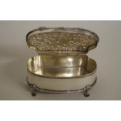 32 - <strong>An Edwardian silver jewel casket,</strong><em>by Henry Matthews,</em> Birmingham 1902,...