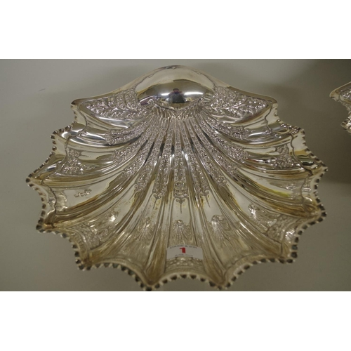 1 - <strong>A pair of Victorian silver clam shell dishes,</strong> having shell supports,<em> ...