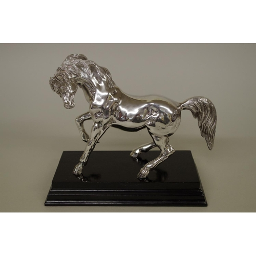 12 - <strong>A filled silver model of a prancing horse</strong>, stamped 925, import mark London 1992, 17...
