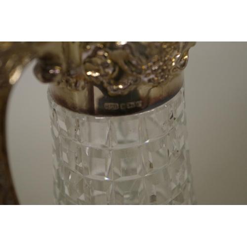 18 - <strong>A silver mounted cut glass claret jug</strong>,<em>by Roberts & Belk,</em>Sheffield 19...