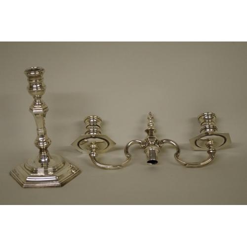 21 - <strong>A cast silver twin branch candelabrum</strong>, <em>by</em><em>William</em> <em>Comyns &...