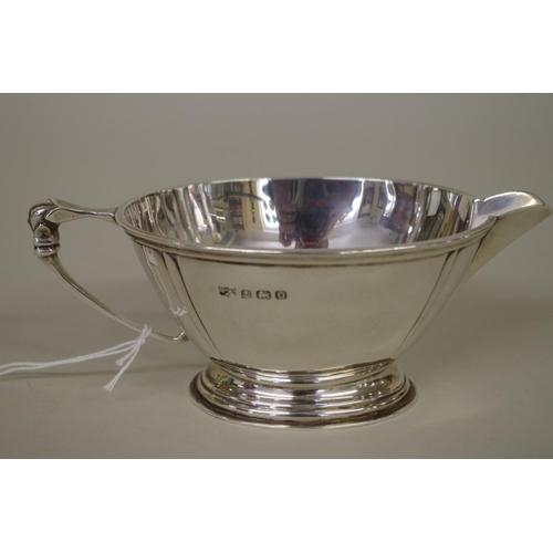 27A - <strong>A silver milk jug, </strong><em>by Mappin & Webb,</em>Birmingham 1913, 6.5cm high, 151g...