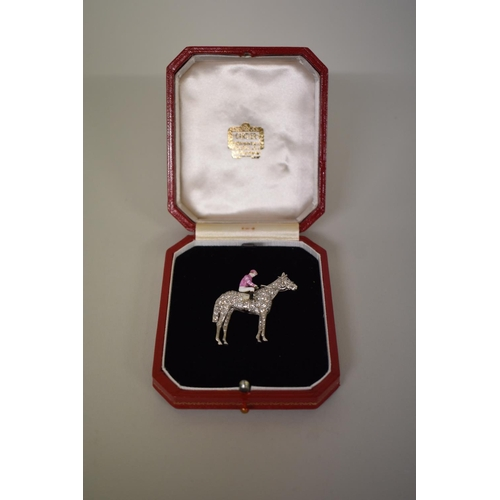 285 - <strong>WITHDRAWN FROM SALE - A diamond encrusted race horse brooch, </strong>with sapphire eye, the...