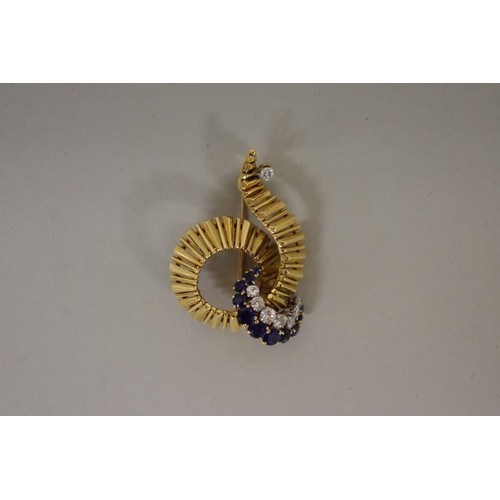 290 - <strong>A gold, diamond and sapphire swirl brooch,</strong>hallmarked 18ct, 1964, 4cm width, 1...