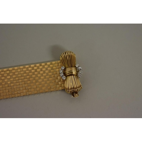 297 - <strong>A 18ct gold mesh bracelet,</strong> having diamond inset bow clasp, stamped 18ct, 105.2g all...