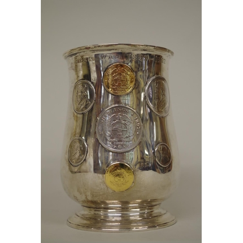 3 - <strong>Of Boer War interest: </strong>a silver baluster mug, inset South African coins commemoratin...
