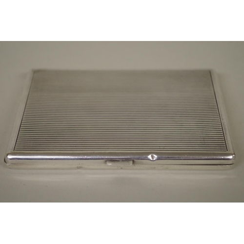 38 - <strong>A Cartier silver cigarette case</strong>, having reeded decoration, 11 x 8cm, 135g all in....