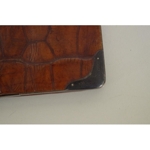 41A - <strong>A crocodile wallet</strong>, having silver mounted corners<em>byFranz Schiebner, </em>Lond...