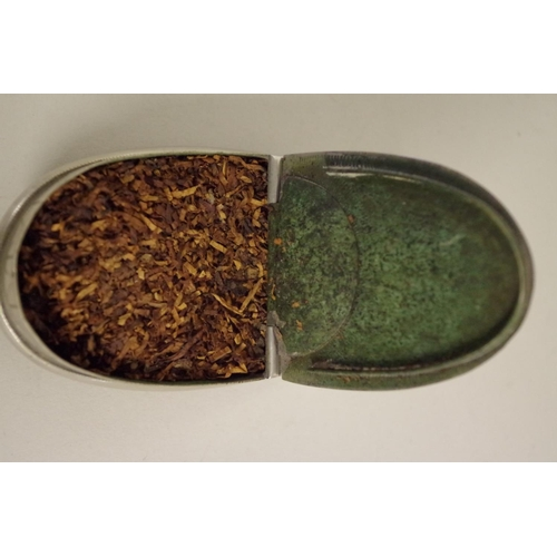 43 - <strong>A nickel snuff box,</strong> having chased floral decoration to lid, inscribed 'W P Green 19...