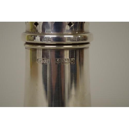 5 - <strong>A silver baluster caster,</strong> <em>by W I Broadway,</em> Birmingham 1988, 17.5cm, 94g...